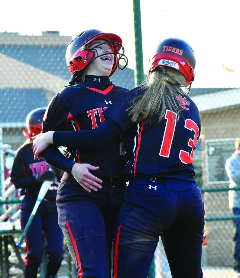 Lexi Gorniak, left, and Katherine Bobinski-Boyd celebrate after scoring on Brooke Webber's double in the 10th inning on Tuesday.