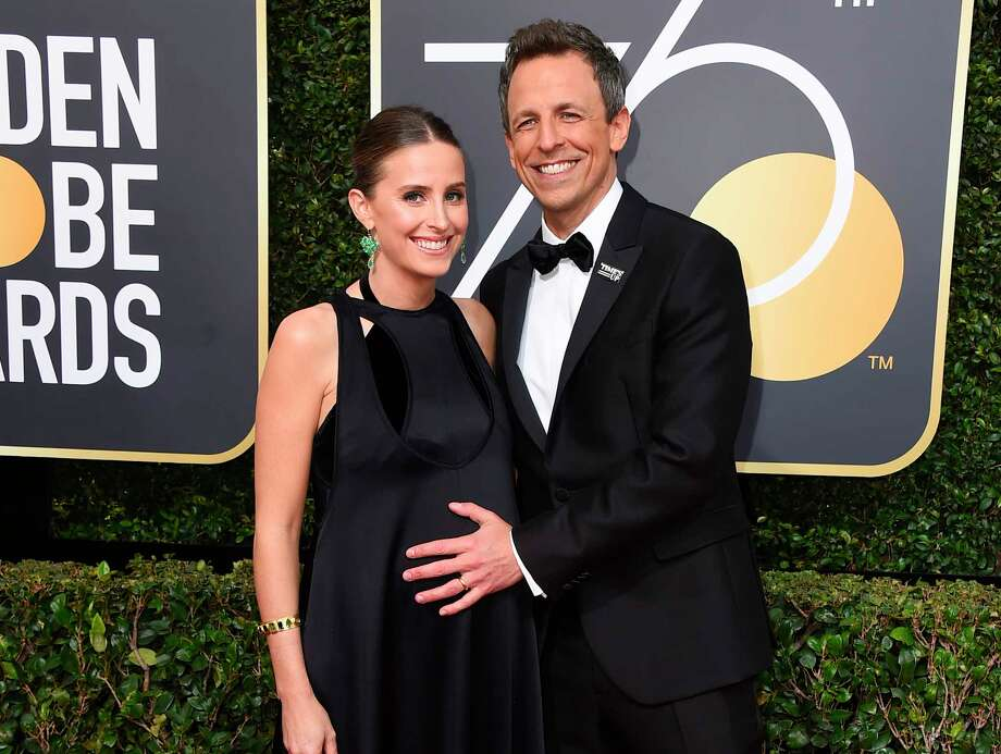 "FILE - In this Jan. 7, 2018 file photo, Alexi Ashe, left, and Seth Meyers arrive at the 75th annual Golden Globe Awards in Beverly Hills, Calif. Myers  host told his audience on ""Late Night with Seth Meyers,"" Monday, April 9, 2018, that his new son was born in the lobby of their apartment building on Sunday. (Photo by Jordan Strauss/Invision/AP, File) Photo: Jordan Strauss / 2018 Invision"