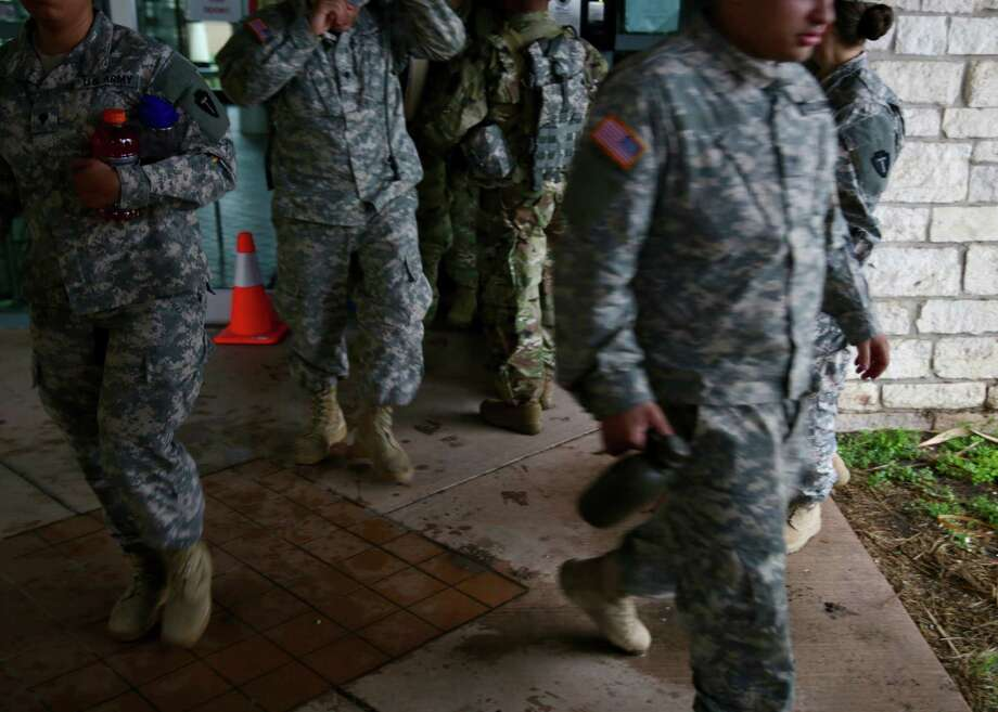 Members of the Texas National Guard gather at the Armory in Weslaco before heading out to a post along the Rio Grande River on Tuesday, April 10, 2018. Photo: Bob Owen, Staff / San Antonio Express-News / San Antonio Express-News