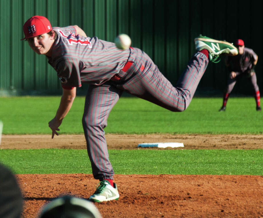 The Woodlands pitcher Steven Beard fires a pitch against Conroe on Tuesday at Conroe High School. Photo: Keith MacPherson