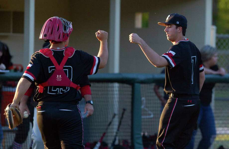 Porter starting pitcher Patrick Hine (7) gets a fist-bump from catcher Brent Sipe (23) during the fourth inning of a District 21-5A high school baseball game at Splendora High School, Tuesday, April 10, 2018, in Splendora. Photo: Jason Fochtman, Staff Photographer / © 2018 Houston Chronicle
