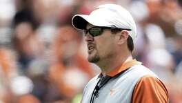 FILE - In this April 15, 2017, file photo, Texas head coach Tom Herman looks on during the Orange and White spring NCAA college football game in Austin, Texas. Lincoln Riley and Tom Herman haves stepped up their roles in the Oklahoma-Texas rivalry.  (Ricardo B. Brazziell/Austin American-Statesman via AP, File)