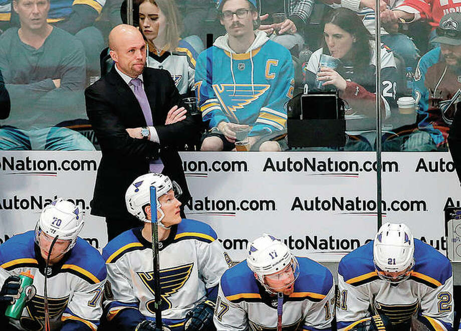 Blues coach Mike Yeo watches the third period of the team's season-ending loss to the Colorado Avalanche in Denver. The loss put an end to their season without a playoff appearance. Photo:       AP