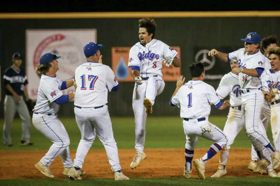 Oak Ridge's Logan Letney (8) celebrates with teammates after scoring a walk off win for the War Eagles during the baseball game against College Park on Tuesday, April 10, 2018, at Oak Ridge High School. (Michael Minasi / Houston Chronicle) Photo: Michael Minasi, Staff Photographer / © 2018 Houston Chronicle