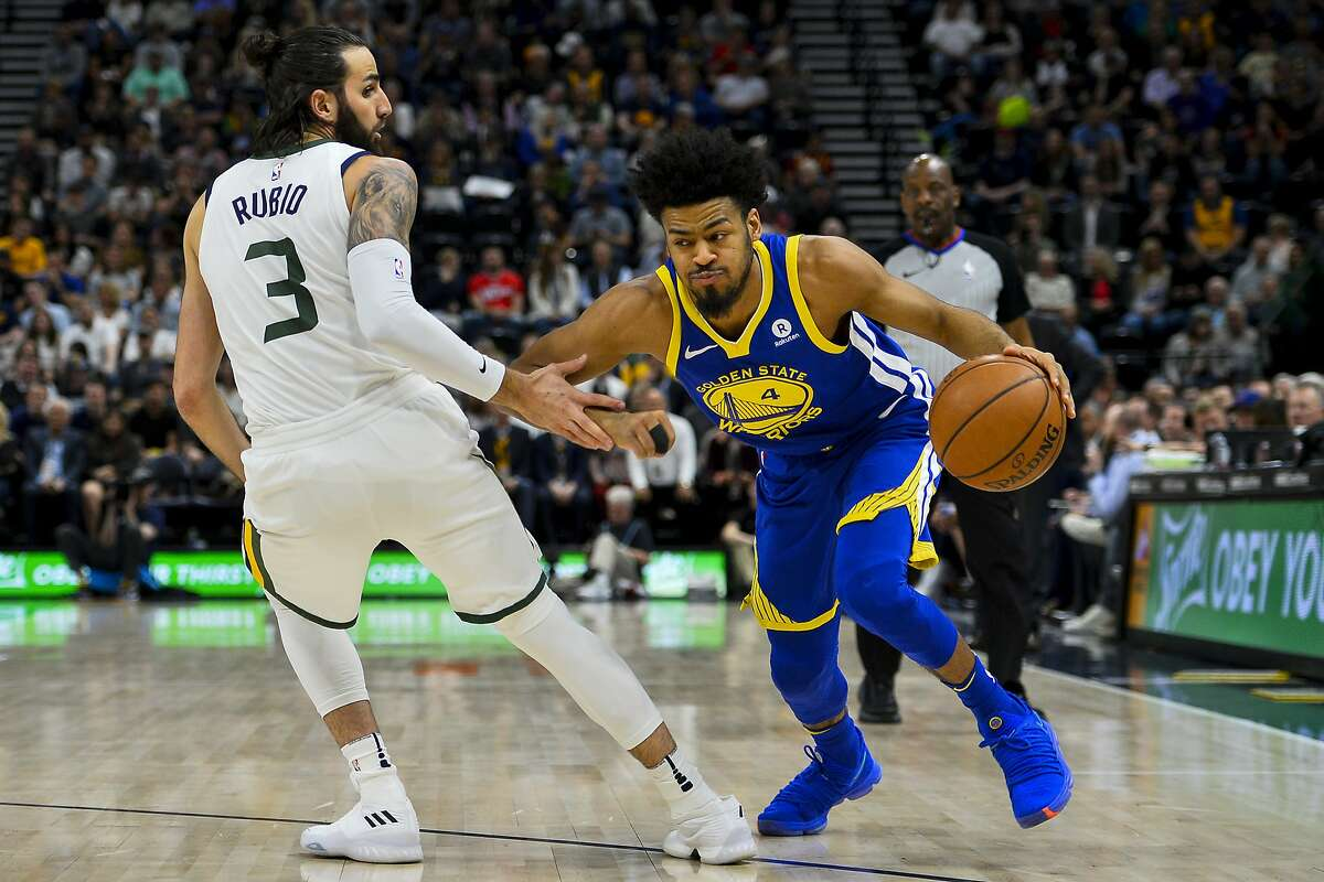 Golden State Warriors guard Quinn Cook (4) drives past Utah Jazz guard Ricky Rubio (3) in the first half of an NBA basketball game Tuesday, April. 10, 2018, in Salt Lake City. (AP Photo/Alex Goodlett)