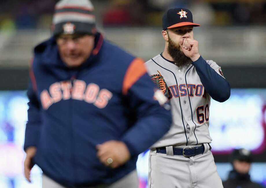 MINNEAPOLIS, MN - APRIL 10: Dallas Keuchel #60 of the Houston Astros looks on as pitching coach Brent Strom #56 heads back to the dugout after a mound visit during the second inning of the game against the Minnesota Twins on April 10, 2018 at Target Field in Minneapolis, Minnesota. Photo: Hannah Foslien, Getty Images / 2018 Getty Images