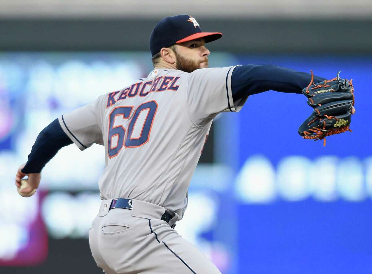 MINNEAPOLIS, MN - APRIL 10: Dallas Keuchel #60 of the Houston Astros delivers a pitch against the Minnesota Twins during the first inning of the game on April 10, 2018 at Target Field in Minneapolis, Minnesota.