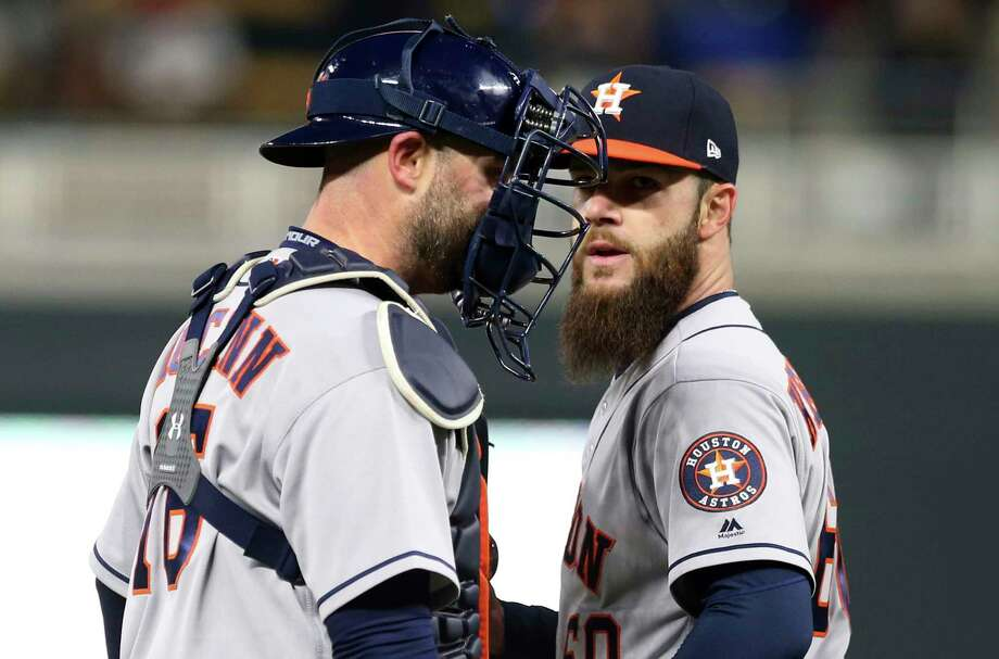 Houston Astros catcher Brian McCann, left, chats with pitcher Dallas Keuchel after Keuchel gave up a walk to Minnesota Twins' Brian Dozier to load the bases during the second inning of a baseball game Tuesday, April 10, 2018, in Minneapolis. (AP Photo/Jim Mone) Photo: Jim Mone, Associated Press / Copyright 2018 The Associated Press. All rights reserved.