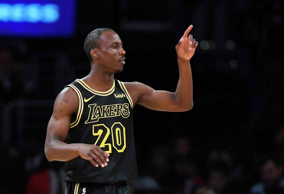 Los Angeles Lakers forward Channing Frye gestures after scoring during the first half of the team's NBA basketball game against the Houston Rockets on Tuesday, April 10, 2018, in Los Angeles. (AP Photo/Mark J. Terrill)