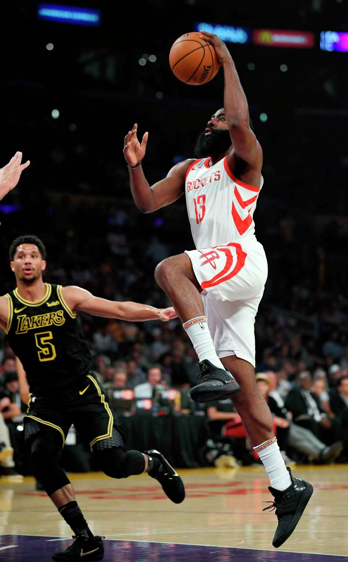 Houston Rockets guard James Harden, right, shoots as Los Angeles Lakers guard Josh Hart defends during the first half of an NBA basketball game Tuesday, April 10, 2018, in Los Angeles. (AP Photo/Mark J. Terrill)