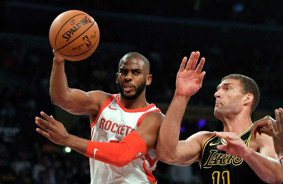 Houston Rockets guard Chris Paul, left, passes the ball as Los Angeles Lakers center Brook Lopez defends during the first half of an NBA basketball game Tuesday, April 10, 2018, in Los Angeles. (AP Photo/Mark J. Terrill) Photo: Mark J. Terrill, Associated Press / Copyright 2018 The Associated Press. All rights reserved.