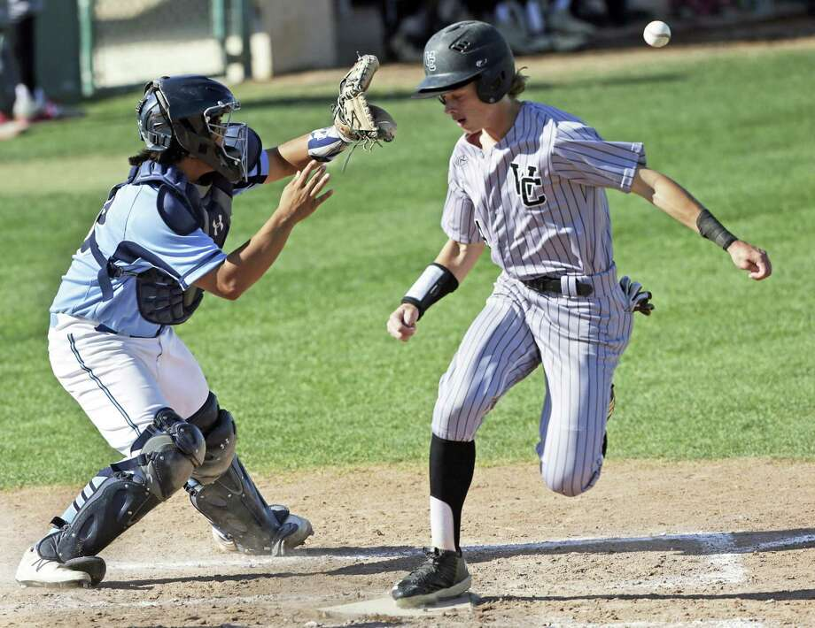Charger base runner Hudson Head makes home plate for his team's second score as Jags catcher Dominic Tamez gets the ball too late from left field on a sacrifice fly as Churchill plays Johnson in District 26-6A baseball at Blossom baseball field on April 10, 2018. Photo: Tom Reel, Staff / San Antonio Express-News / 2017 415916Z.1 ANTONIO EXPRESS-NEWS