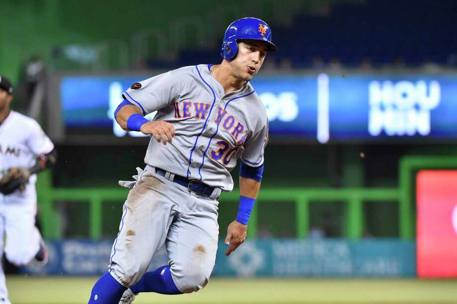 MIAMI, FL - APRIL 10: Michael Conforto #30 of the New York Mets rounds third base during the first inning against the Miami Marlins at Marlins Park on April 10, 2018 in Miami, Florida. (Photo by Eric Espada/Getty Images) Photo: Eric Espada / 2018 Getty Images
