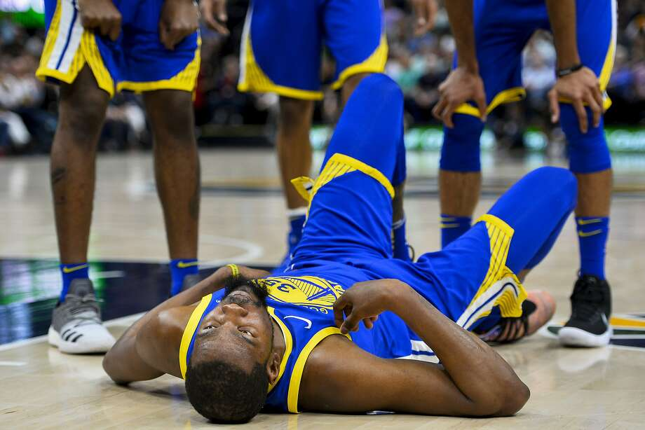 Golden State Warriors forward Kevin Durant (35) lays on the ground in the first half of an NBA basketball game against the Utah Jazz Tuesday, April. 10, 2018, in Salt Lake City. Photo: Alex Goodlett / Associated Press