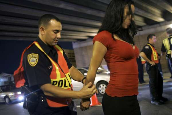 MIAMI - DECEMBER 15: Officer Kevin Millan from the City of Miami Beach police department arrests a woman after she failed a field sobriety test at a DUI checkpoint December 15, 2006 in Miami, Florida. The women failed a breathalyzer test by blowing into the device and receiving two readings one at .190 the other .183, which is twice the legal limit in Florida. The city of Miami, with the help of other police departments, will be conducting saturation patrols and setting up checkpoints during the holiday period looking to apprehend drivers for impaired driving and other traffic violations. (Photo by Joe Raedle/Getty Images)