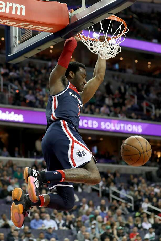 John Wall reached 5,000 career assists as Washington kept its hopes of jumping from the eighth to sixth seed alive Tuesday. Photo: Rob Carr / Getty Images