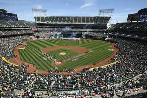 The Los Angeles Angels and the Oakland Athletics stand for the national anthem at the Oakland Coliseum prior to an opening day baseball game on Thursday, March 29, 2018 in Oakland, Calif. (AP Photo/Ben Margot)