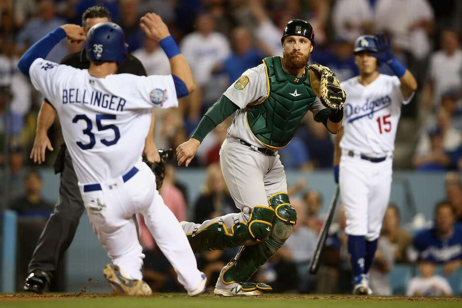 Cody Bellinger of the Dodgers scores on a Logan Forsyth double in the sixth inning. Jonathan Lucroy awaits the throw. Photo: Sean M. Haffey / Getty Images