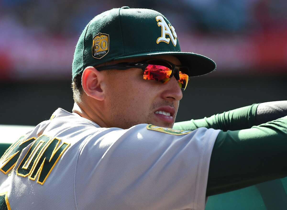Trayce Thompson #32 of the Oakland Athletics sits in the dugout during the game against the Los Angeles Angels at Angel Stadium of Anaheim on April 8, 2018 in Anaheim, California. (Photo by Jayne Kamin-Oncea/Getty Images)