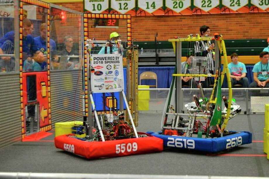 The robots from Midland and H.H. Dow high schools are shown together at a prior competition. (Photo provided)