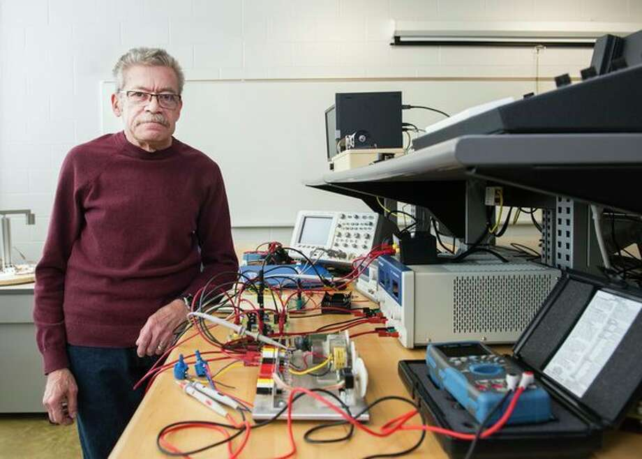 John Leonard works with circuitry as part of his job as a Saginaw Valley State University laboratory support coordinator. Leonard is a finalist for the FIRST Robotics Woodie Flowers Award for his efforts to empower students as a mentor for the BlitzCreek Robotics team at Bullock Creek High School. (Tim Inman, SVSU)