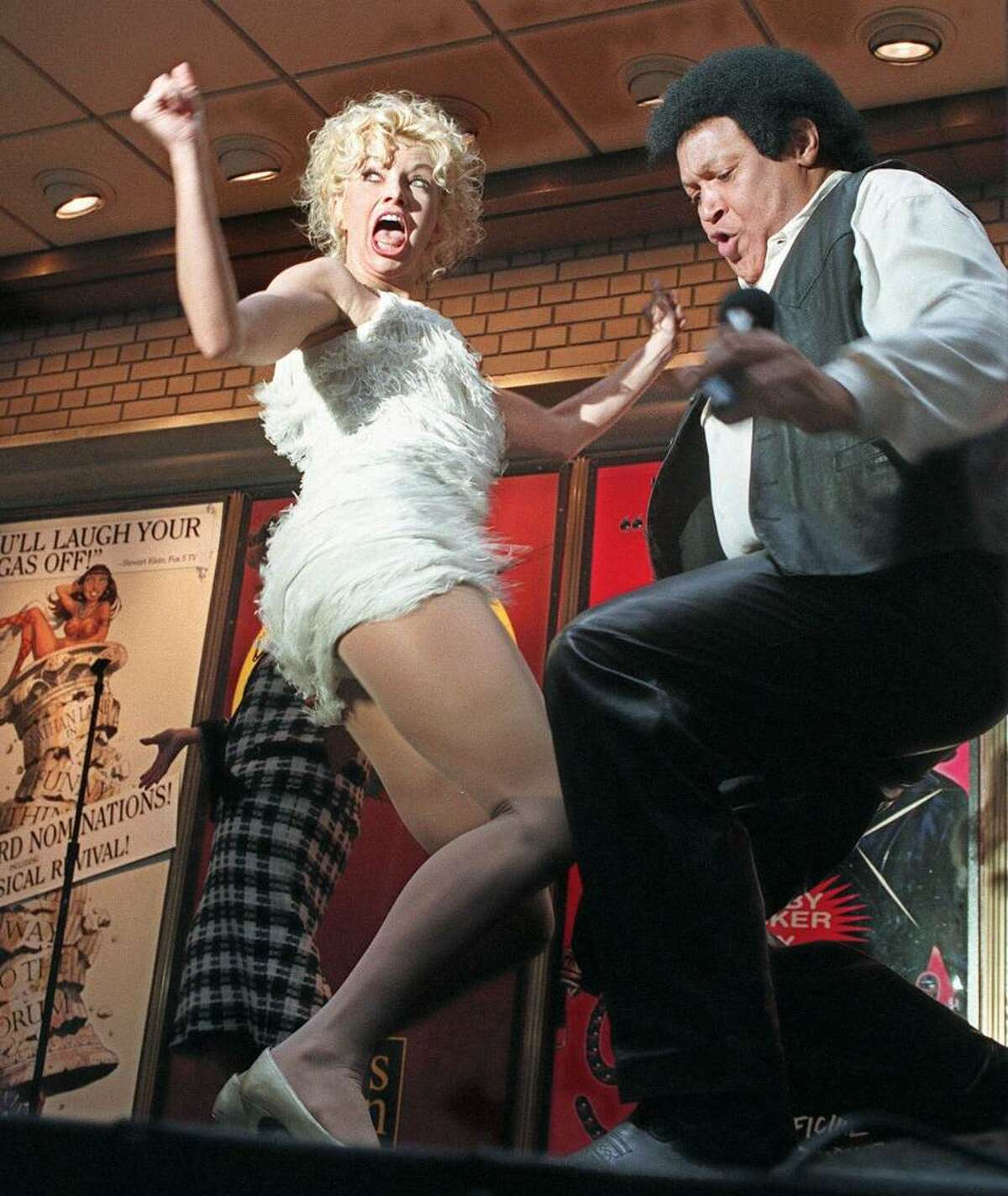 DeLee Lively, left, and Chubby Checker twist in New York in 1996. (AP Photo/Richard Drew)