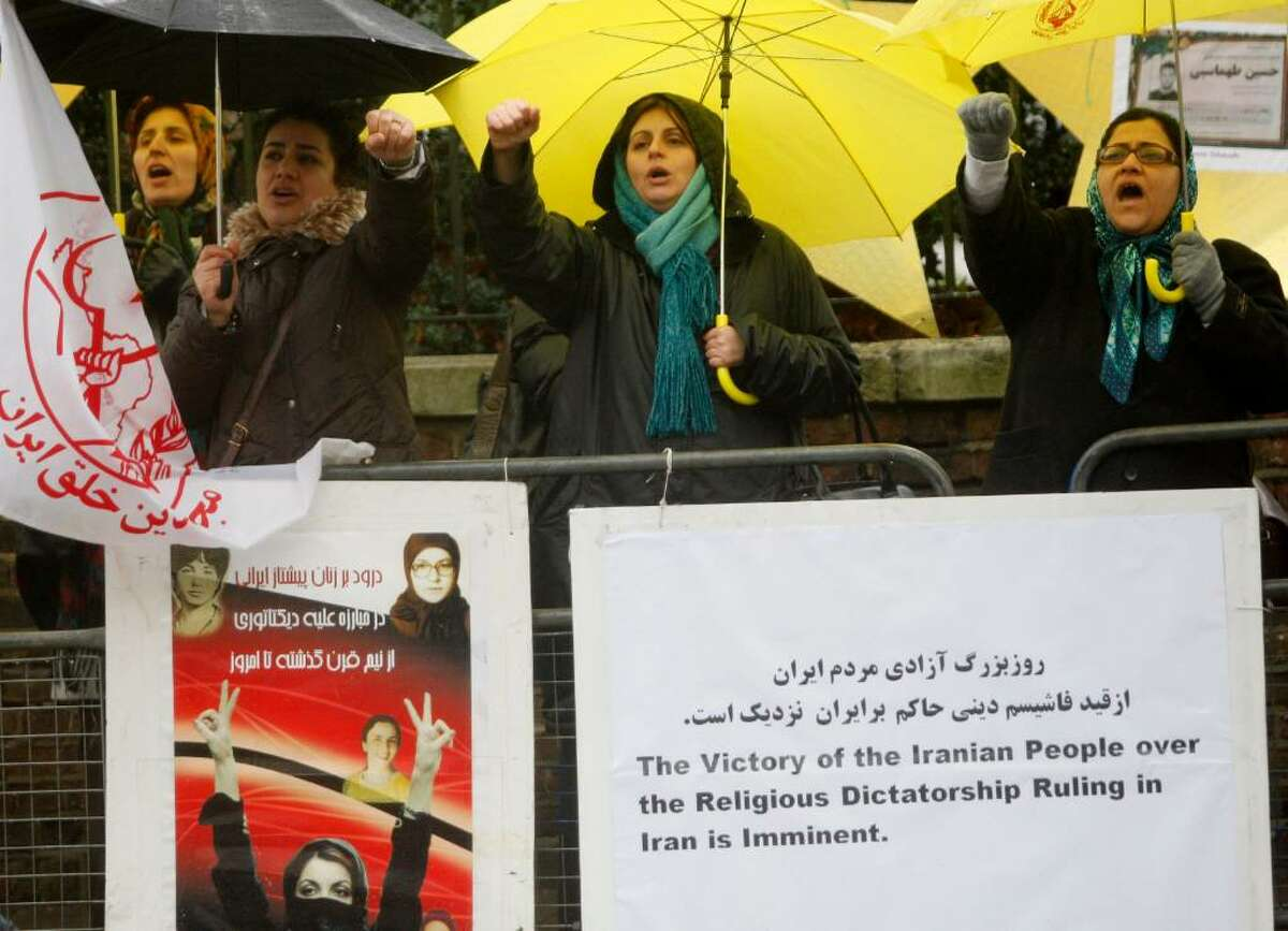 Supporters of the People's Mujahedeen Organization of Iran protest outside the Iranian Embassy in London to show their solidarity with the Iranian people who are demonstrating in Iran against the government, Tuesday, Dec. 29, 2009. Iranian security forces made a wave of new arrests Tuesday, including Nobel peace laureate Shirin Ebadi's sister and a relative of opposition leader Mir Hossein Mousavi, pressing forward with a broadening crackdown on the reformist movement in the wake of deadly protests this week.The government accused Western countries of fomenting the violence, threatening to