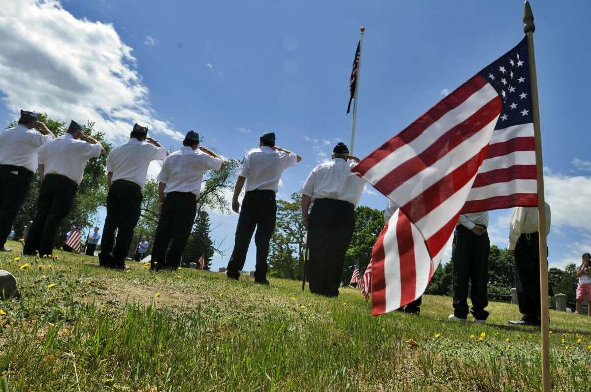 Members of the Sons of the American Legion, Gerald O'Neil Squadron 1683, salute the flag during the dedication of a new flagpole in Beverwyck Cemetery in Rensselaer during a service just before the start of the annual Memorial Day Parade there on Sunday May 30, 2010. ( Philip Kamrass / Times Union)