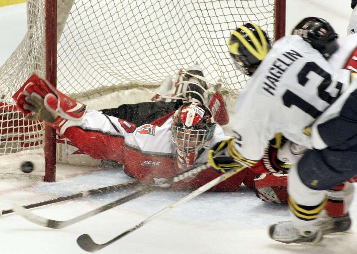 RPI goalie Allen York stops a shot by Michigan's Carl Hagelin. (AP Photo/Jerry S. Mendoza)