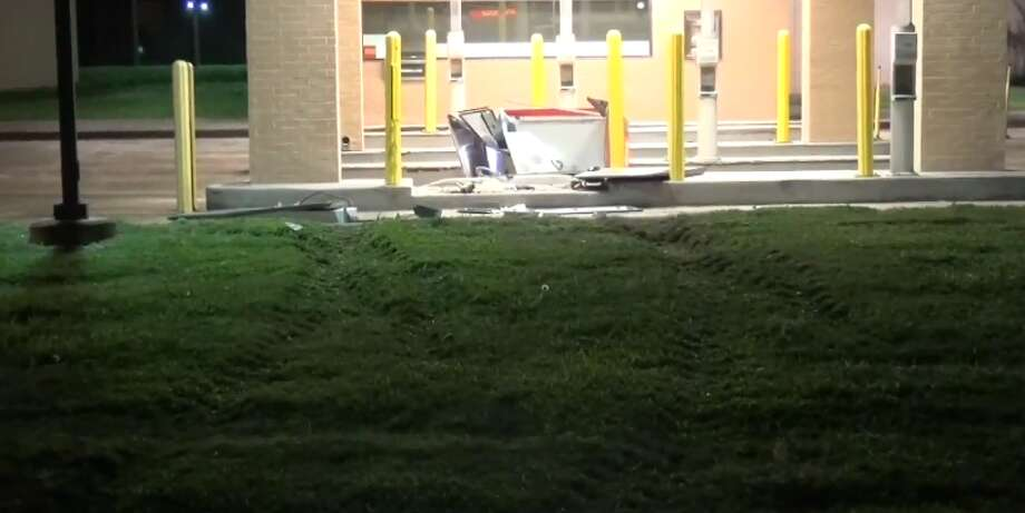 Two men wearing hoodies used an industrial forklift to smash open the ATM outside a Wells Fargo bank at 12200 Northwest Freeway, on Wednesday April 11, 2018. Photo: Metro Video