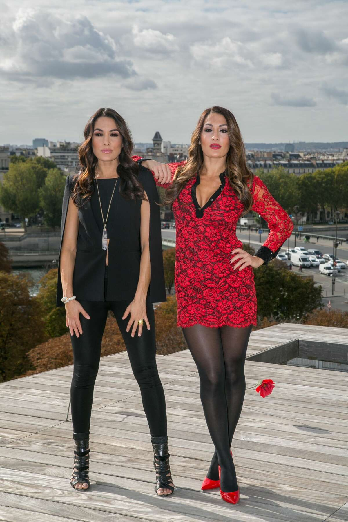 PARIS, FRANCE - OCTOBER 08: (L-R) WWE Divas Brie Bella and Nikki Bella attend a photocall to promote their show 'Total Divas' on October 8, 2015 in Paris, France. (Photo by Marc Piasecki/Getty Images)