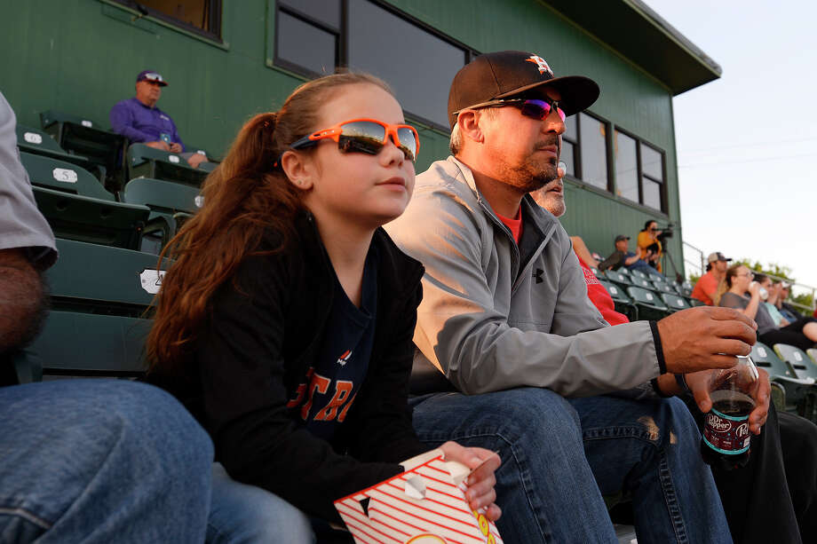 Patrick and Avery Owen, 9, wear Houston Astros attire to watch as the Lamar Cardinals baseball team takes on Northwestern State at Vincent-Beck Stadium.  Photo taken Tuesday 4/10/18 Ryan Pelham/The Enterprise Photo: Ryan Pelham / ©2018 The Beaumont Enterprise/Ryan Pelham