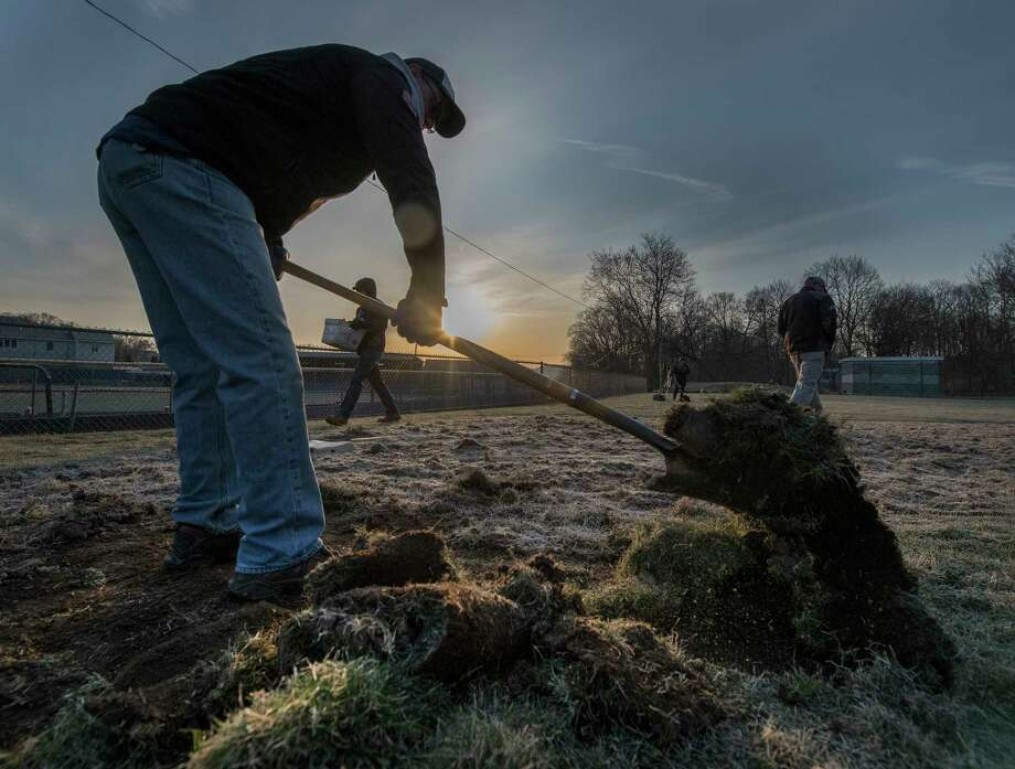 """Tru-City ValleyCats COO Rick Murphy removes old sod in preparation for new sod at the American Little League field, First Avenue and Krank Street in Albany Wednesday April 11, 2018  in Albany, N.Y. The work continues by volunteers from the ValleyCats, Hannaford and Blue Shield of Northeastern N.Y. all day as part of the """"4 in 24"""" program where four little league fields are renovated in less than 24 hours by volunteers.  (Skip Dickstein/Times Union) Photo: SKIP DICKSTEIN, Albany Times Union / 20043474A"""