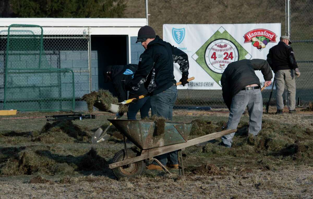 Volunteers remove old sod in preparation for new sod at the American Little League field, First Avenue and Krank Street in Albany Wednesday April 11, 2018 in Albany, N.Y. The work continues by volunteers from the ValleyCats, Hannaford and Blue Shield of Northeastern N.Y. all day as part of the