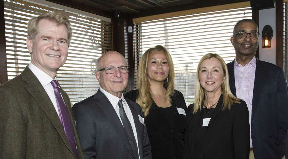 More than 50 people were on hand for a March 28 fundraiser at 348 Oyster Bar in  Fairfield to support Bridgeport Hospital's REACH outpatient psychiatric program. Pictured: Dr. Thomas Knox, Ridgefield-based psychiatrist and REACH supporter; Emil Meshberg and Sonja Narcisse; Bridgeport Hospital Foundation trustees; Donna Twist, Foundation vice president; and Dr. Charles Morgan, hospital chair of Psychiatry and Behavioral Health. Photo: Contributed / Bridgeport Hospital