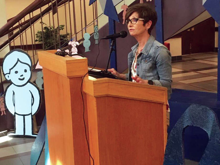 Janel Angell, with the Illinois Department of Children and Family Services, speaking at a ceremony kicking off Child Abuse Prevention Month. Photo: Steve Horrell • Shorrell@edwpub.net