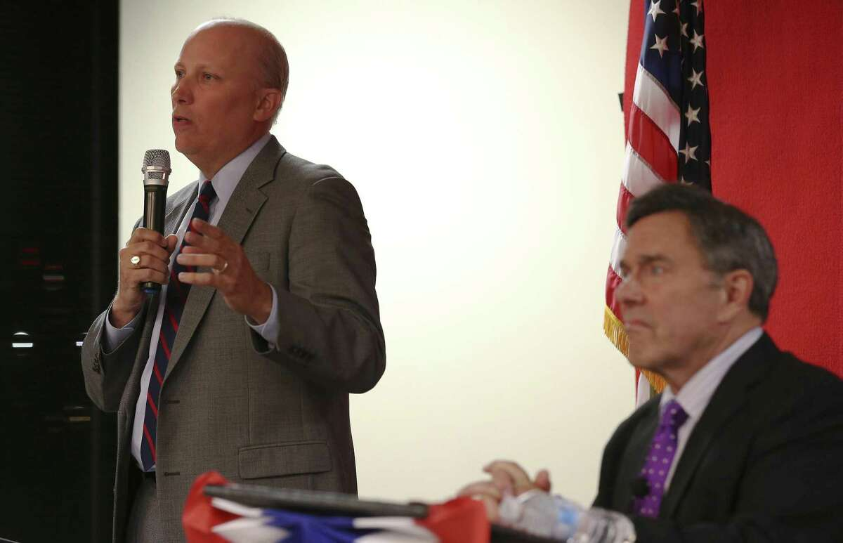 Chip Roy (left), former chief of staff to Ted Cruz, answers a question Tuesday evening during a debate sponsored by the local chapter of the Texas Young Republicans and moderated by Chris Marrou (right). About 100 people attended the debate held at Bexar County Republican Party headquarters.