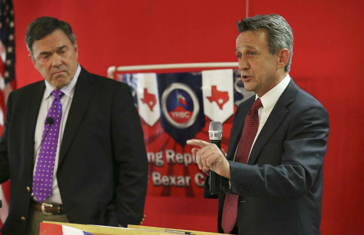 Matt McCall (right), a Boerne native and two-time challenger to the incumbent Rep. Lamar Smith, answers a question Tuesday at the debate moderated by anchor Chris Marrou (left).