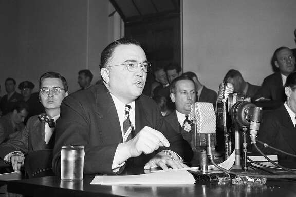 """This March 26, 1947, file photo shows Federal Bureau of Investigation Director J. Edgar Hoover calling the communist party of the United States a """"Fifth Column"""" whose """"goal is the overthrow of our government"""" during testimony before the House Un-American Activities Committee in Washington. Fearing a Russian invasion and occupation of Alaska, the U.S. government in the early Cold War years recruited and trained fishermen, bush pilots, trappers and other private citizens across Alaska for a covert network to feed wartime intelligence to the military, newly declassified Air Force and FBI documents show. Hoover teamed up on a highly classified project, code-named �Washtub,� with the newly created Air Force Office of Special Investigations, headed by Hoover protege and former FBI official Joseph F. Carroll. (AP Photo/File)"""