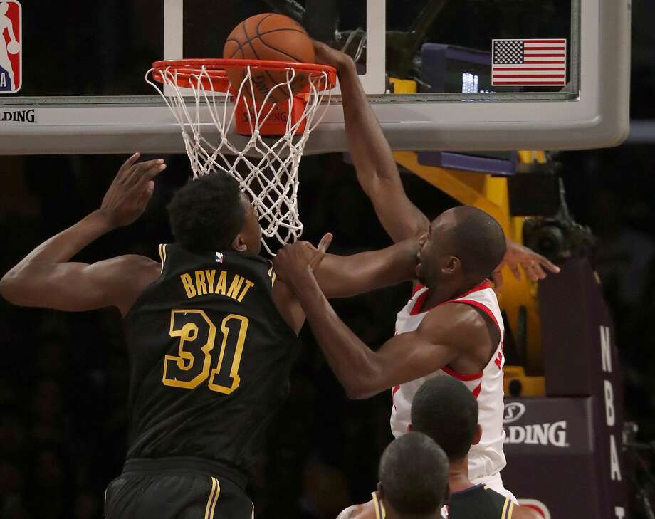 Houston Rockets forward Luc Mbah a Moute dunks the ball against Los Angeles Lakers center Thomas Bryant in the second quarter on Tuesday, April 10, 2018, at Staples Center in Los Angeles, Calif. (Luis Sinco/Los Angeles Times/TNS) Photo: Luis Sinco/TNS