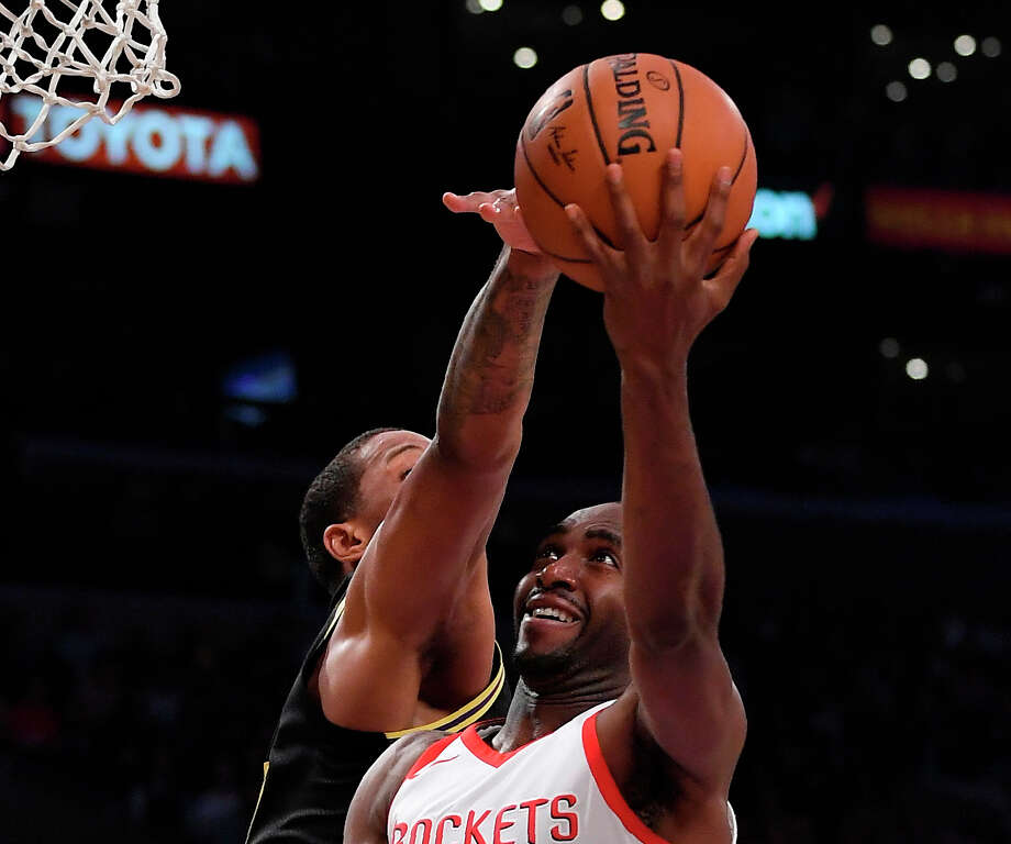 Houston Rockets forward Luc Mbah a Moute, right, shoots as Los Angeles Lakers forward Channing Frye defends during the first half of an NBA basketball game Tuesday, April 10, 2018, in Los Angeles. (AP Photo/Mark J. Terrill) Photo: Mark J. Terrill/Associated Press