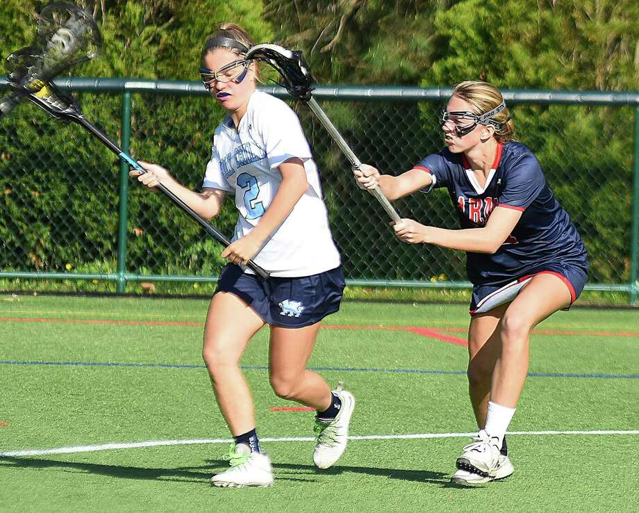 GFA's Bella Litt, right, a resident of Darien, defends an opponent. Photo: Contributed Photo / Darien News contributed