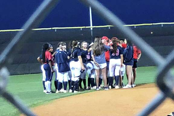 Coach Ashley Boyd addresses the Atascocita softball team after their 7-0 win over Summer Creek on April 10 at Summer Creek.