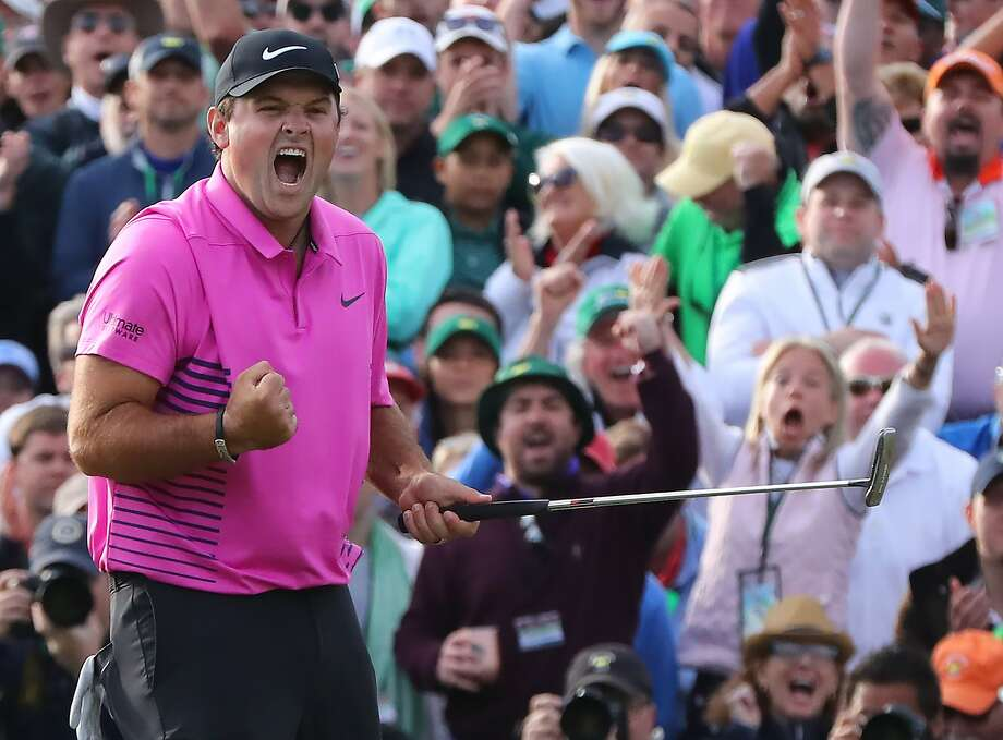 Patrick Reed makes a par putt on the 18th green to win the Masters at 15-under par at Augusta National Golf Club on Sunday, April 8, 2018, in Augusta, Ga. (Curtis Compton/Atlanta Journal-Constitution/TNS) Photo: Curtis Compton / TNS