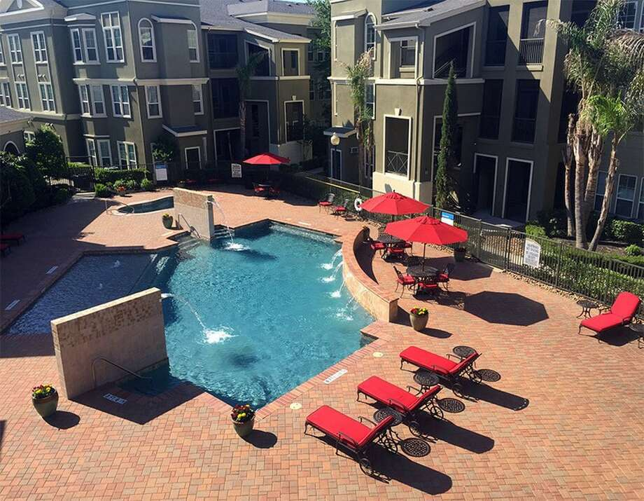 Kings Cove Apartments at 4920 Magnolia Cove Drive in Kingwood has new furniture and landscaping in the pool area. Photo: National Asset Services