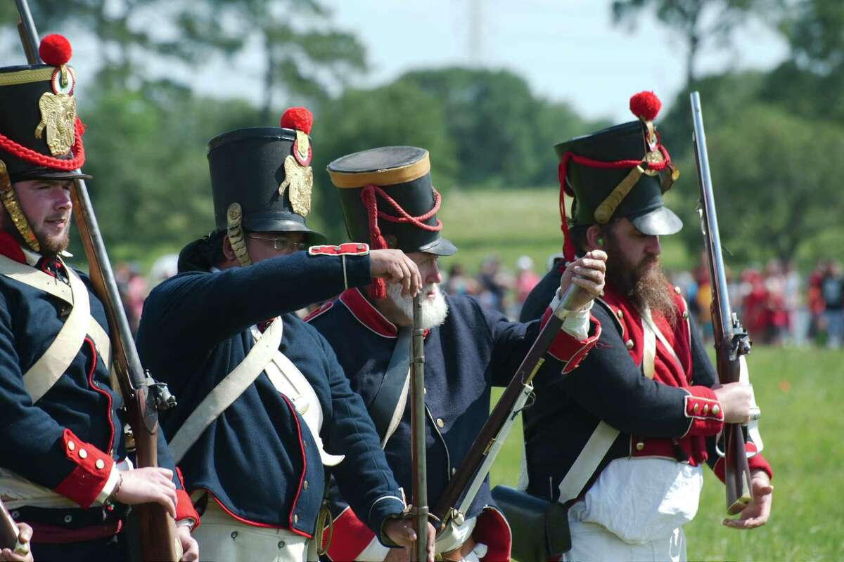 History enthusiasts wear replica uniforms and fire historically accurate muskets used by the Mexican Army History in the Battle of San Jacinto during a reenactment of the battle.