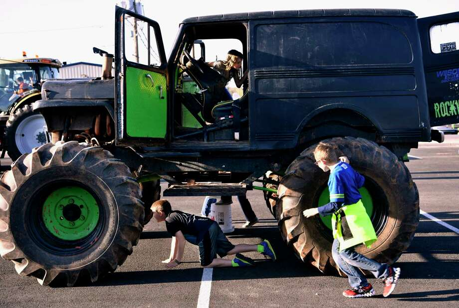 In a Wednesday April 4, 2018 photo, children crawl beneath, into, and run around Joey Roland's monster truck at Calvary Baptist Church in Snyder, Texas. Touch-A-Truck featured ten service vehicles for children in the church youth group to inspect up-close and interact with. (Ronald W. Erdrich/The Abilene Reporter-News via AP) Photo: Ronald W. Erdrich, AP / Abilene Reporter-News