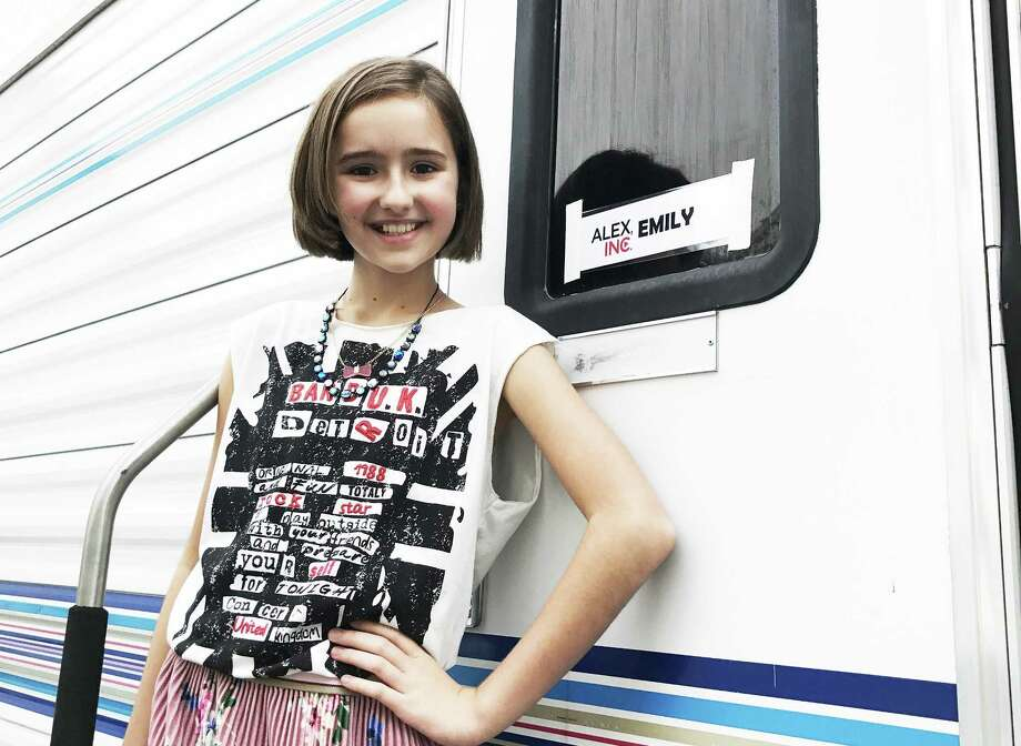 "San Antonio native Gabriella Graves, 12, relaxes in front of her ABC trailer during a break in shooting sitcom ""Alex, Inc.,"" in which she plays the girlfriend of one of the leads. Photo: Courtesy Of Michelle Graves"