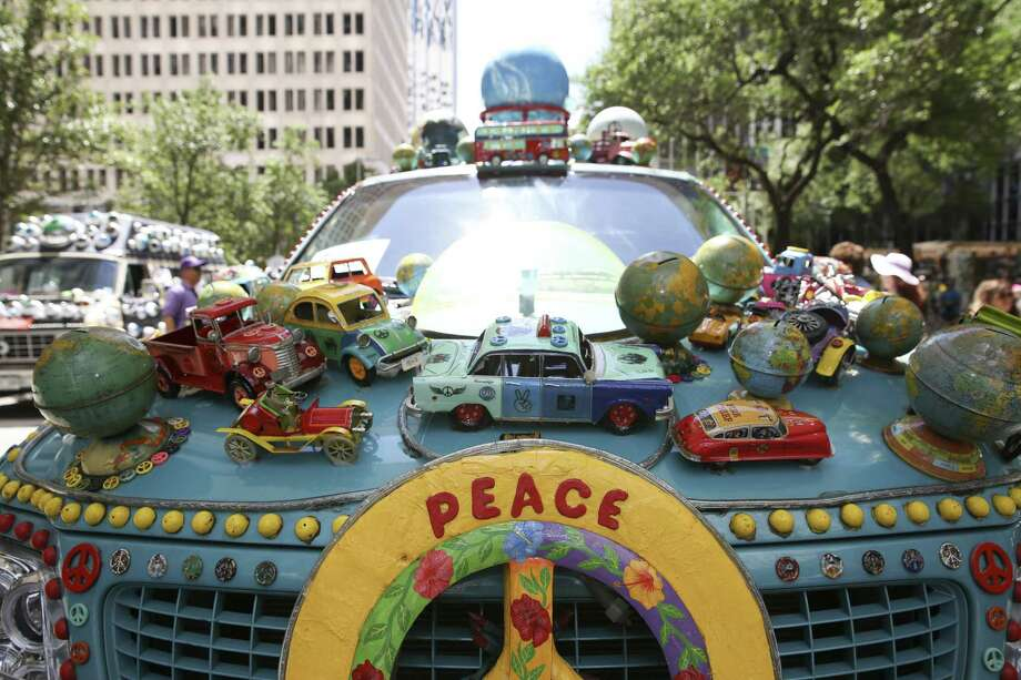 """PHOTOS: Art Car Parade highlights from 2017 """"Peace Expedition"""" is full of globes and transportation vehicles. The 31st annual Houston Art Car Parade is Saturday, April 14, and rolls through downtown Houston. See more photos from last year's parade... Photo: Yi-Chin Lee, Staff / Houston Chronicle / © 2017  Houston Chronicle"""