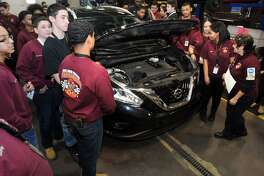 Automotive Technology students at Bullard-Havens Technical High School gather around a Nissan Murano in Bridgeport, Conn. April 10, 2018. The Murano was donated to the school by Nissan to help the students with their automotive repair training